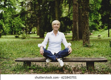 Vibrant mid age woman laughing in park