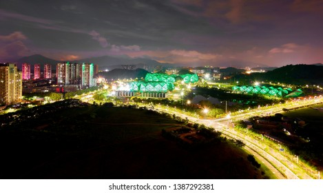 Vibrant panoramic view of typical Chinese landscape with residential buildings and high ways in Shenzhen tonight