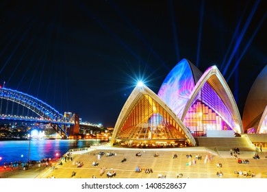 A vibrant photo of the Sydney Opera House one of Sydney's biggest icons during the Vivid Festival in Sydney - Sydney, NSW, Australia - 25 May 2019
