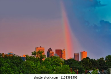 A vibrant rainbow creates a whimsical display with sunset colors in the sky over Columbus, Ohio.