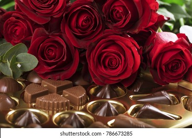 Vibrant red roses on a box of chocolates for valentine's day, or any day to say I love you.
