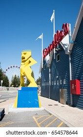 Vibrant sculpture with Cicerello's restaurant in Fremantle, Western Australia/Male Sculpture/FREMANTLE,WA,AUSTRALIA-NOVEMBER 13,2016:Vibrant sculpture and Cicerello's in Fremantle, Western Australia
