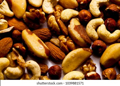 Vibrant Selection of Organic Nuts on White Work Surface