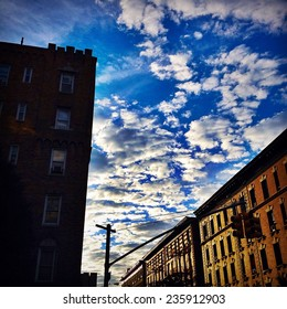 Vibrant sky and clouds in New York City with Instagram effect filter.
