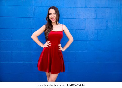 Vibrant stylish latina woman in flashy red dress full of color and personality
