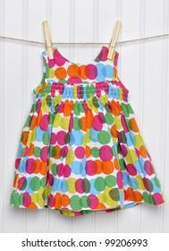 Vibrant Summemrtime Baby Girl Dress on a Clothesline.