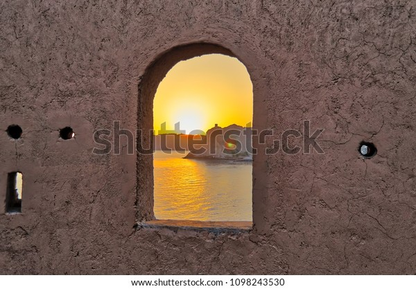 vibrant-sunrise-silhouetting-old-watchto