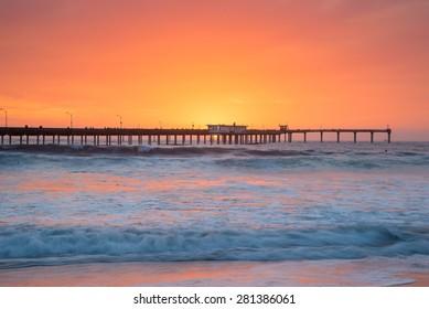 A vibrant sunset by the Ocean Beach pier in San Diego