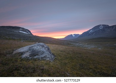 Vibrant sunset over the rocky Sarek plains Sweden