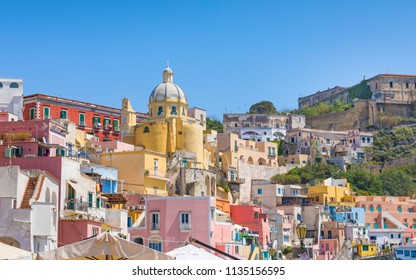 Vibrantly colorful housing of Marina Corricella in sunny summer weather at Procida island, Italy. Procida Island is located between Capo Miseno and Ischia island in Tyrrhenian sea.