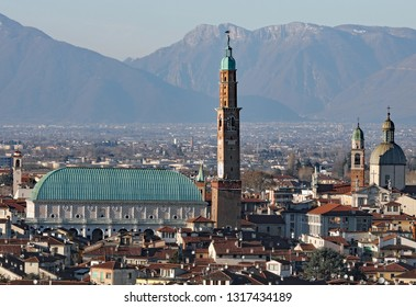 Vicenza City and the Basilica Palladiana with high tower caller Torre Bissara in Italian Language and more bell towers of old churches