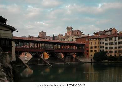 Vicenza - Italy - 01-02-2010: The Ponte Vecchio (Old bridge) or Ponte degli Alpini is a covered wooden pontoon bridge located in Bassano del Grappa. The bridge spans the river Brenta.