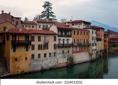 Vicenza - Italy - 01-02-2010: view from the Ponte Vecchio (Old bridge) or Ponte degli Alpini, a covered wooden pontoon bridge located in Bassano del Grappa. The bridge spans the river Brenta.