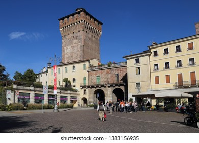 Vicenza, Italy - October 2, 2018: Tourists stand in front of the Porta Castello gate and tower in Vicenza, Italy on October 2, 2018
