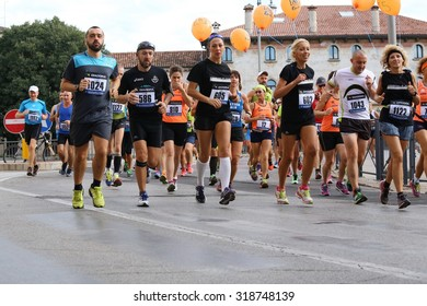 """Vicenza, VI, Italy. 20th September 2015.  Marathon runners during the race called """"Mezza di Vicenza"""" in city street of Vicenza in Northern Italy.The runners have raced meters 21097."""