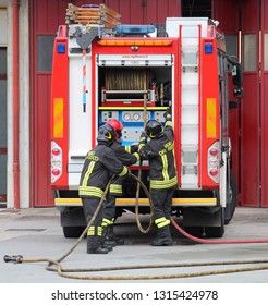 Vicenza, VI, Italy - May 10, 2018: fire truck and talian firefighters with uniform during fire drill