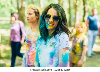 VICHUGA, RUSSIA - JUNE 17, 2018: Festival of colors Holi. Portrait of a young happy girl with a face in paint