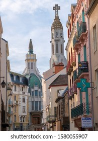 Vichy, Auvergne / France - Nov 26, 2019: A street perspective with the Art Deco style Church Saint-Blaise.