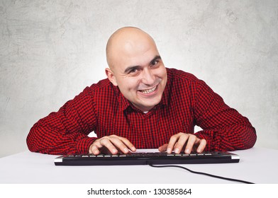Vicious hacker typing on computer keyboard