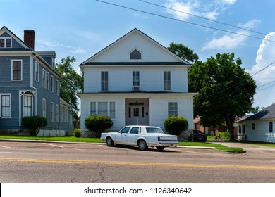 Vicksburg, Mississippi - June 21, 2014: Vintage car parkerd in front of a wood house in the city of Vicksburg, Mississippi, USA.