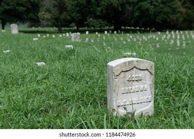 Vicksburg, USA - June 22, 2014: Detail of the tombstone of an unknown soldier at the Vicksburg National Cemetery, in Vicksburg, Mississippi, USA