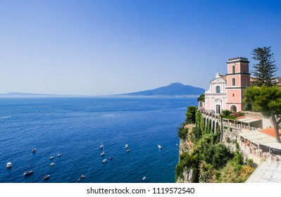 Vico Equense. Italy July 22,2017: Vico Equense. Italy. Hotel Sporting. La chiesa di Santissima Annunziata, the volcano Mount Vesuvius in the background.