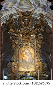 Vicoforte, Italy - August 17, 2016: Sanctuary of Vicoforte, Virgin Mary miraculous icon surrounded by angels baroque sculptures in Piedmont, Italy