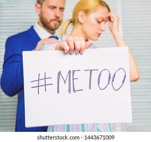 Victim assault at workplace. Assault targeted at employee. Girl hold poster hashtag me too while colleague calm down her. Share assault story. Looking for support. Discrimination assault complaint.
