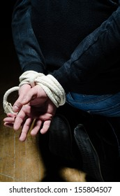 Victim male having his hands tight with a rope