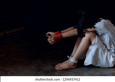 A victim tied up with rope. Stop violence against children. Stop abusing violence.
