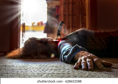 A victim of a violent crime lies in an apartment