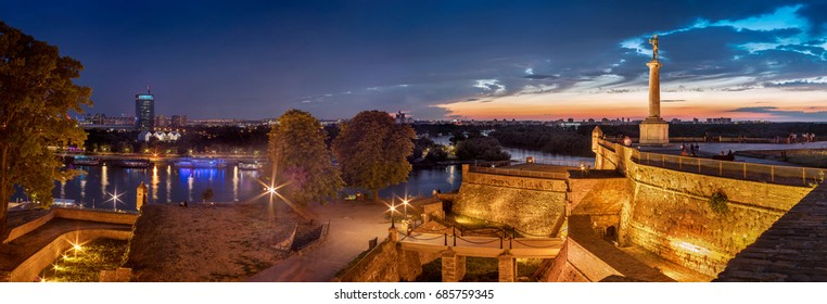 Victor monument on Kalemegdan fortress Belgrade Usce by night with Sava and Danube confluence