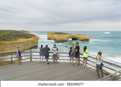 Victoria, Australia - November 25, 2015: Tourists taking photos in London Arch, one of the popular spots along the Great Ocean Road, during daytime.