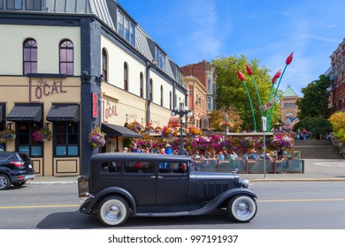 VICTORIA, BC CANADA - AUG 24 2017  A vintage car in the inner city of Victoria during full summer glow.
