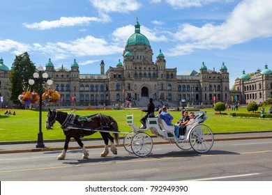 Victoria BC Canada  Aug 25 20917: Coach with tourists at the Parliament House, what is also a symbol for the city itself.