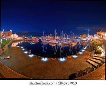 Victoria BC, Canada - December 15 2019. Inner Harbor in Victoria BC, Vancouver Island, Canada, decorated with festive lights during Christmas time