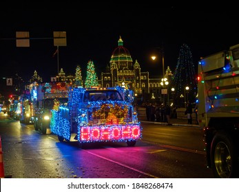 VICTORIA BC, CANADA - DECEMBER 2, 2017: Truck Light Parade, annual celebration of Christmas organized by Island Equipment Owners Association. Trucks decorated with Christmas lights parade downtown