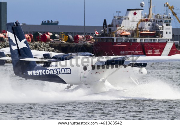 VICTORIA, BC, CANADA - JULY 14 2016: Westcoast Air Float-plane  in the inner harbor. This transportation is vital and very frequent between Vitoria and Vancouver, also the flight is very pictures.