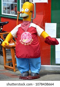 VICTORIA BC CANADA JUNE 15 2015: Homer Simpson puppet in front a store. Homer Jay Simpson is a fictional character and the main protagonist of the American animated sitcom The Simpsons