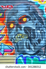 VICTORIA BC CANADA JUNE 22 2015: Robot Skull mural in Victoria is the perfect place to walk in the back alleys and abandoned areas, looking for street art