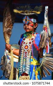 VICTORIA BC CANADA JUNE 24 2015: Unidentified Native Indian boy in traditional costume. First Nations in BC constitute a large number of First Nations governments and peoples in the province of BC