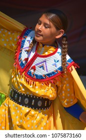 VICTORIA BC CANADA JUNE 24 2015: Unidentified Native Indian girl in traditional costume. First Nations in BC constitute a large number of First Nations governments and peoples in the province of BC
