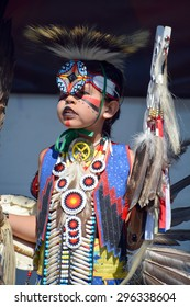 VICTORIA BC CANADA JUNE 24 2015: Native Indian unidentified child in traditional costume. First Nations in BC constitute a large number of First Nations governments and peoples in the province of BC