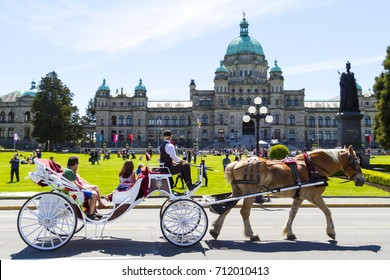 Victoria BC Canada  May 20 20917: Coach with tourists at the Parliament House,what is also a symbol for the city itself.  Victoria is one of the oldest cities in the Pacific Northwest,