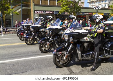 Victoria BC Canada  May 22,2017:  Victorian Police Force marching on the Victoria Day parade.  This is Victoria's largest parade and attracting well over 100,000 people from Canada and the USA..
