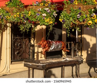 Victoria, British Columbia, Canada, 2-24-2018. A whole pig is roasted outdoors at a restaurant on the Inner Harbour