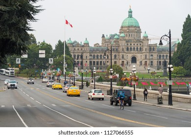 Victoria, British Columbia, Canada - 7 September 2017: Morning traffic on Government street and British Columbia Legislature in the background
