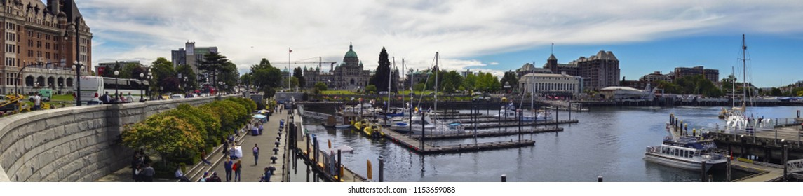 Victoria, British Columbia, Canada - May 31, 2018: Downtown Waterfront with view of BC Legislature Building and World Famous Empress Hotel