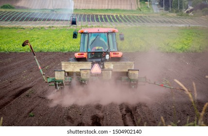 Victoria British Columbia/Canada - 06/25/2019: A tractor plows a farmers field preparing it for planting on Vancouver island, Canada