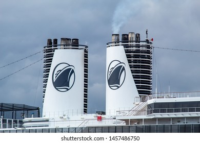 VICTORIA, CANADA - May 3, 2019: Holland America Line logos are seen on the exhaust stacks of a docked ship at the port in Victoria, BC.